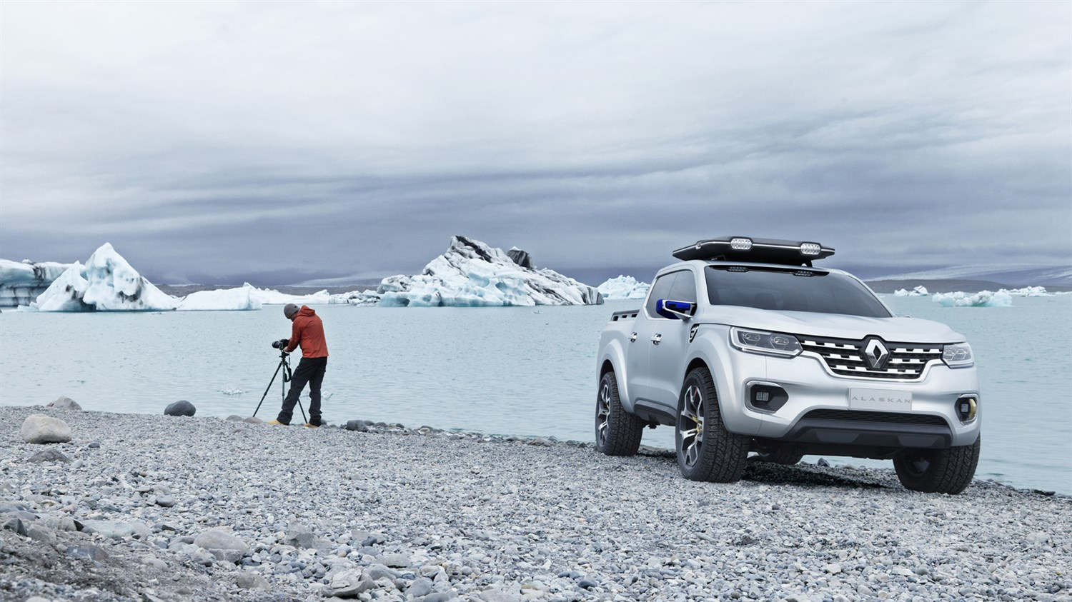 A man standing and clicking picture next to his Renault ALASKAN concept car