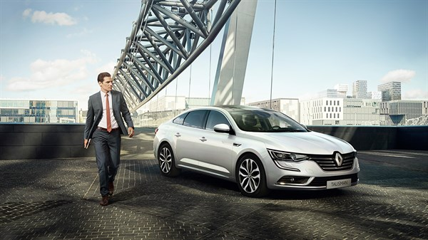 A Business man with Renault TALISMAN in urban environment